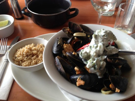 Mussel and Steak Bar: Seafood Coconut Curry with Mussels, Squid, Salmon, Pilaf Rice and Cucumber Raita