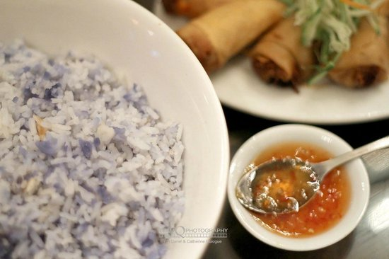Precious Old China: Rice colored and scented with bungah telang, spring rolls in the background.