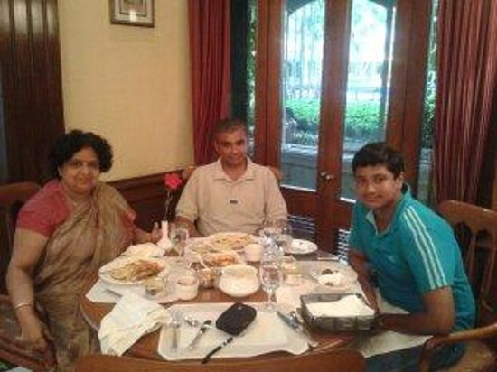 The Oberoi Grand: We three are enjoying lunch.