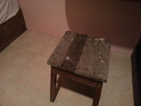 AC Resort : Old, dirty stool in the room.