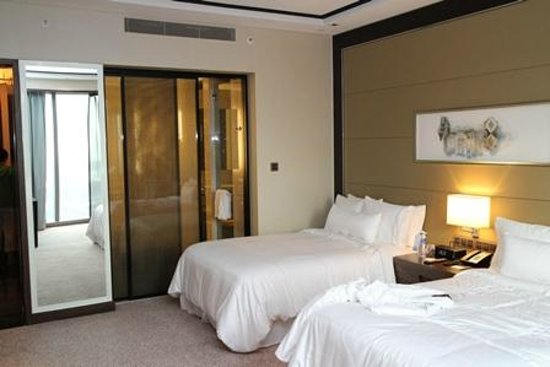 bedroom with sliding door to bathroom - Picture of The Westin ...