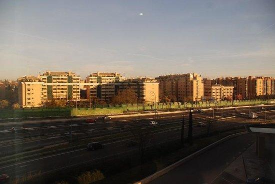 Hilton Madrid Airport : Sunrise over..major road and apartment blocks