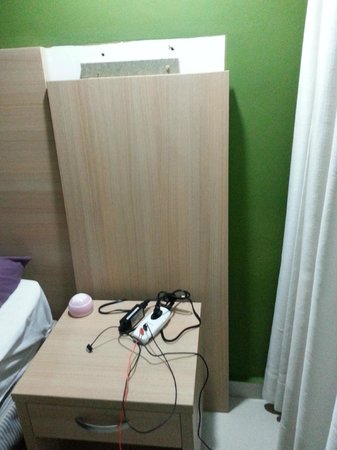 Hotel Beach House Playa Dorada : part of head board that fell off the wall almost hitting me