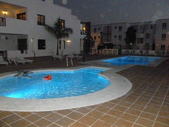 Club Atlantico : Heated pool lit up at night.