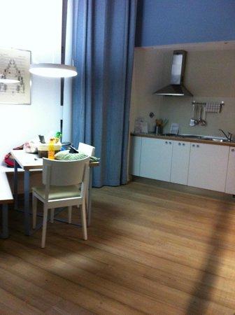 Villa Aruch: Comedor y cocina del departamento