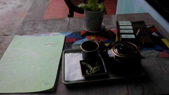 Reaching Out Tea House: Green tea in a tea pot