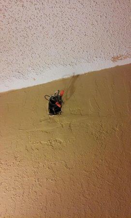 Regency Inn: Wires exposed near ceiling