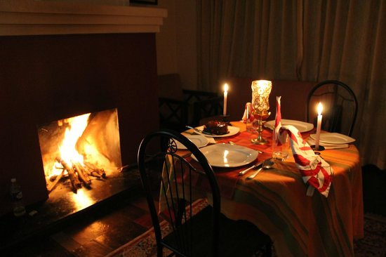 Camp Noel: fireplace & candlenight dinner setup