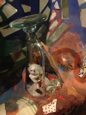 Philadelphia's Magic Gardens : A Wine glass embedded into the mosaic with folk art inside