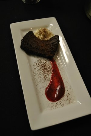 Rhapsody : Flourless Chocolate Torte w/Sweet Cream & Berry Coulis