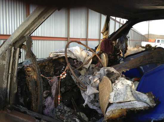 Motel 6 Albuquerque South - Airport: front of van that was burned at motel 6