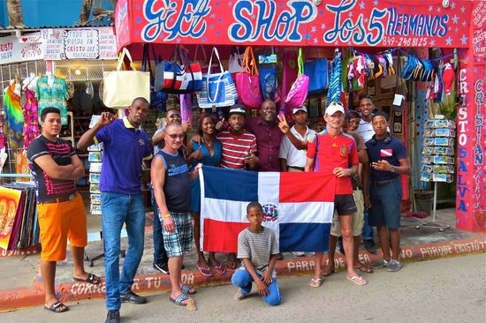 Friendly Boca Chica residents pose in front of a local business