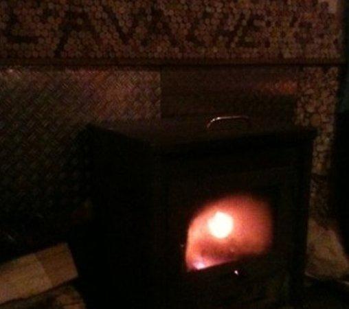 La Vache : The warm and cosy log fire!