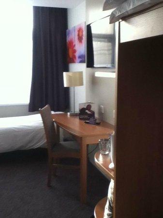 Premier Inn London Putney Bridge Hotel: dressing table with tv on wall above