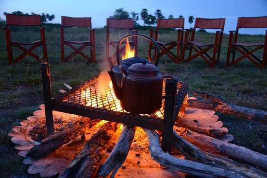 Great Plains Conservation Selinda Camp: Pre-dawn fireside tea before going out on safari at Selinda Camp