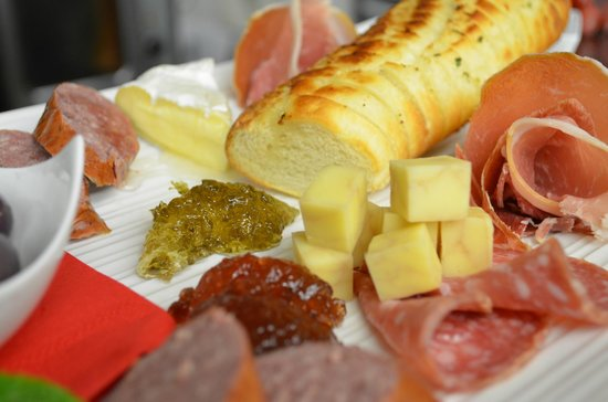 Fluid Bar and Grill: Charcuterie Plate with fresh, local meats and cheeses