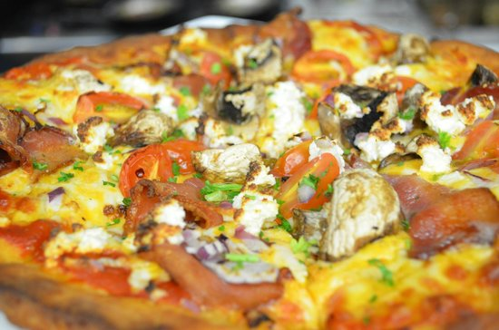 Fluid Bar and Grill: We have four delicious pizza choices, all freshly made to order
