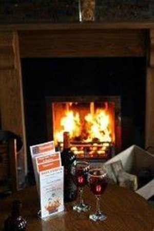 The Bell Guesthouse: open fire in the bar