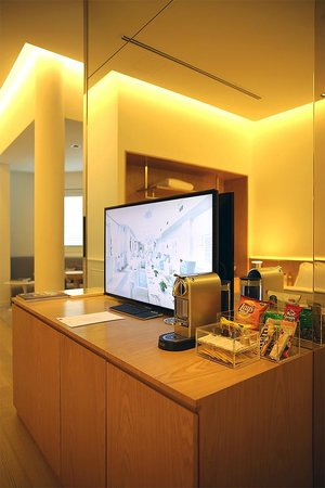 Macalister Mansion : One of the TVs in the room and complimentary mini bar