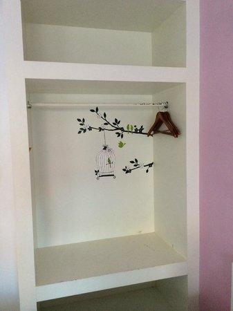 Clear House Guest House: open closet- cute artwork