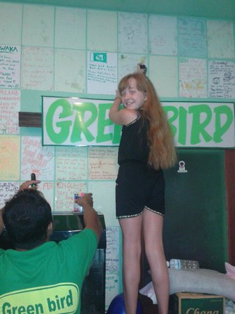 Green Bird: Number one customer updating her post on the wall.