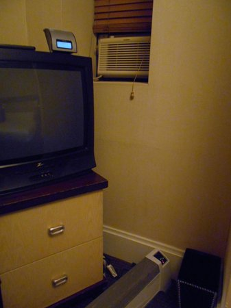 "Amsterdam Court Hotel: AC in ""window"", TV, and room heater"