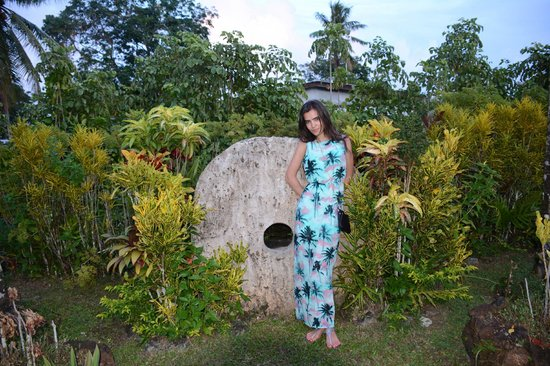 Yap Pacific Dive Resort: My wife with the stone money detail in the garden