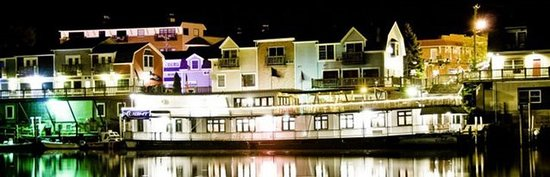 Looking at Old Harbor Inn at night.
