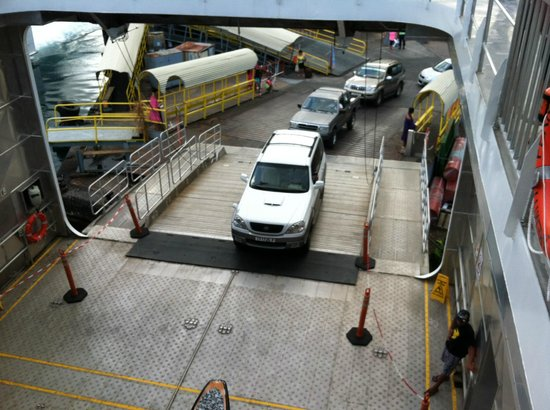 Aremiti Ferry : You can see the other ramp that goes directly in the path of this line of cars to the slow boat