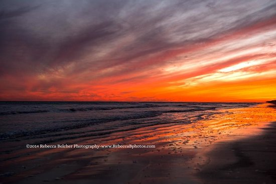 The Seawall: Sunset on the beach in Galveston