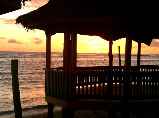 Taufua Beach Fales: Sunset behind our open fale