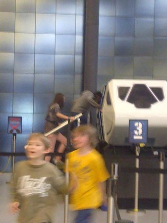 Smithsonian National Air and Space Museum Steven F. Udvar-Hazy Center : My kids were having fun in the simulators