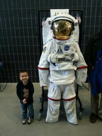 Smithsonian National Air and Space Museum Steven F. Udvar-Hazy Center : My boy with an astronaut uniform.