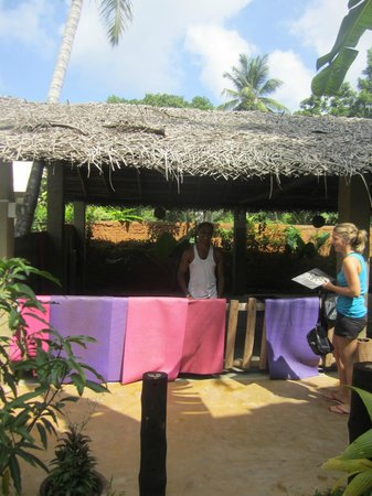 Yoga with Asiri: The garden where yoga is practised under the thatched roof.