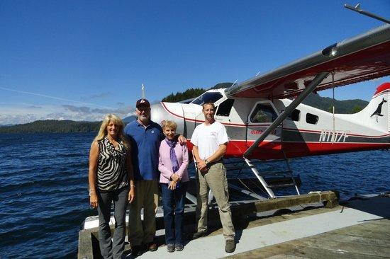 Island Wings Air Service: Us with Michelle, her assistant and her plane at Traitor's Cove.