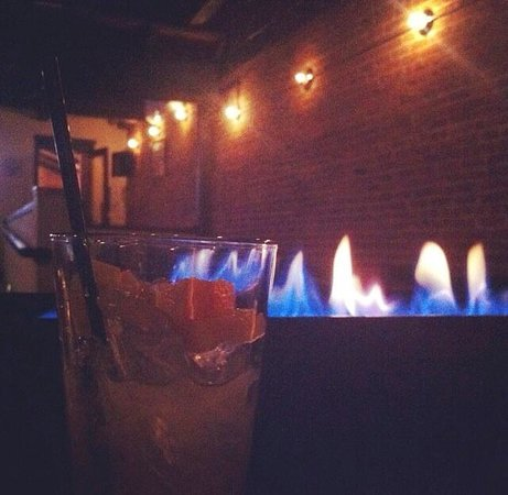 Sena on Myrtle: a view of the patio and firepit table
