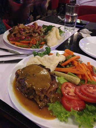 Rendezvous: Coq Au Vin and Veal Cordon Bleu with bland vegetables