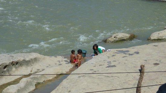 Wisma Leuser Sibayak : Villagers taking bath and washing