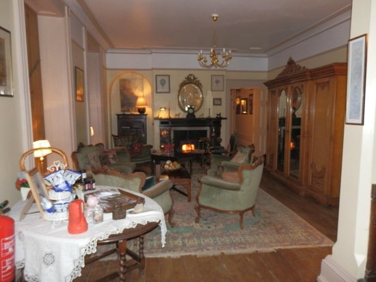 Glewstone Court: Sitting rooms with roaring fires