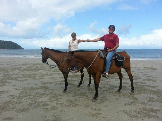 Cape Tribulation Horse Rides: My husband and I riding on the beach at Cape Trib