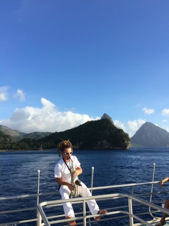 Anse Chastanet: Jazzy sunset cruise with hotel and Pitons in the background