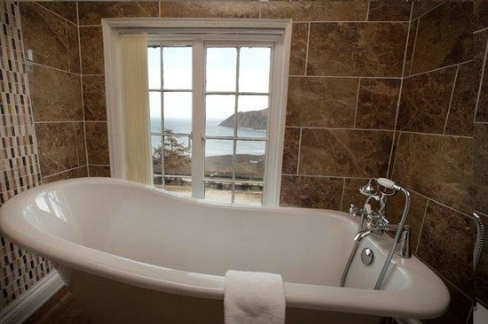 Lynton Cottage Hotel: C S Lewis Suite with magnificent sea views and en suite bathroom with Slipper bath