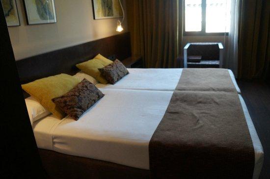 Vincci Centrum: Кровать в номере