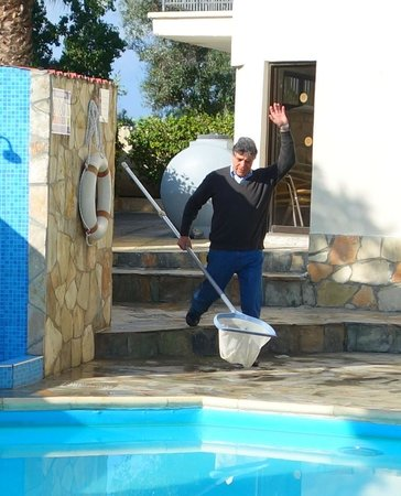 Crystallo Apartments : George cleaning his pool