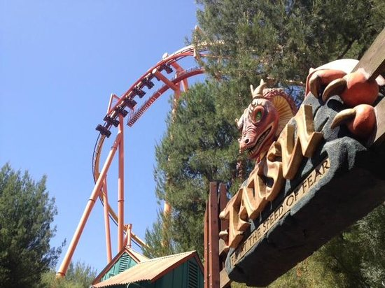 Six Flags Magic Mountain: Overlook of Tatsu entrance and train going through the lift hill.