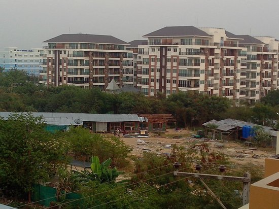 Pattaya Garden Apartments: Worker housing being dismantled across the street...