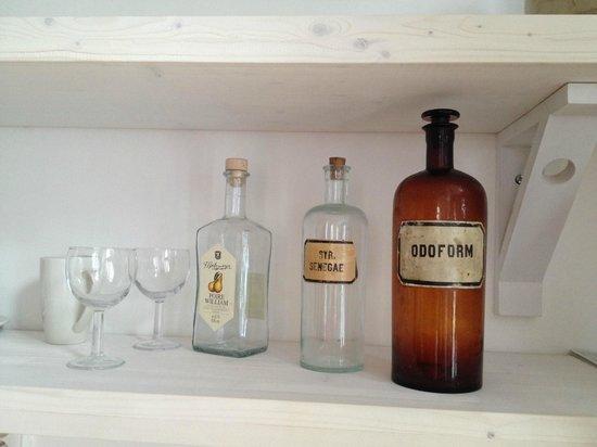 NYX Prague : little details in the suite - original vintage bottles used as decoration