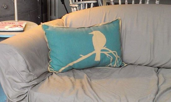 The BANK Coffee House: Comfy sofa with this charming pillow just waiting to cuddle a guest.  Just charming.