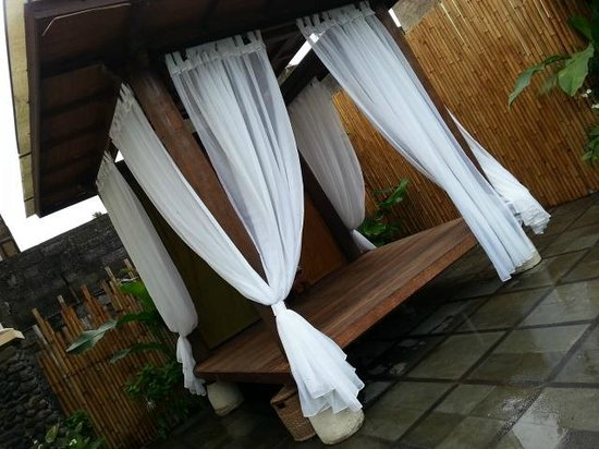 Desamuda Village : Outdoor seating by the Pool