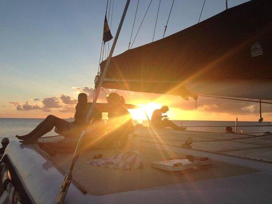 Cool Runnings Catamaran Cruises: Sun setting during dinner